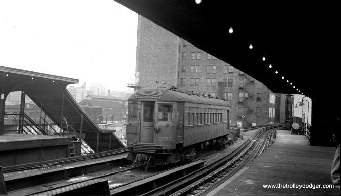 "North Shore Line car 255 is laying over on middle storage track at the Roosevelt Road station on the Chicago ""L"". Don's Rail Photos"": ""255 was built by Jewett in 1917. It had all of the seats removed in the 1920s to provide a full length baggage car which ran in passenger trains. It was used for the Chicago Symphony Orchestra to move equipment to Ravinia. On July 2, 1942, the 40 seats were replaced. Then on December 1, 1946, the seats were again removed. In addition to the Symphony, the car was used for sailors' baggage from Great Lakes."" (C. Edward Hedstrom, Jr. Photo)"