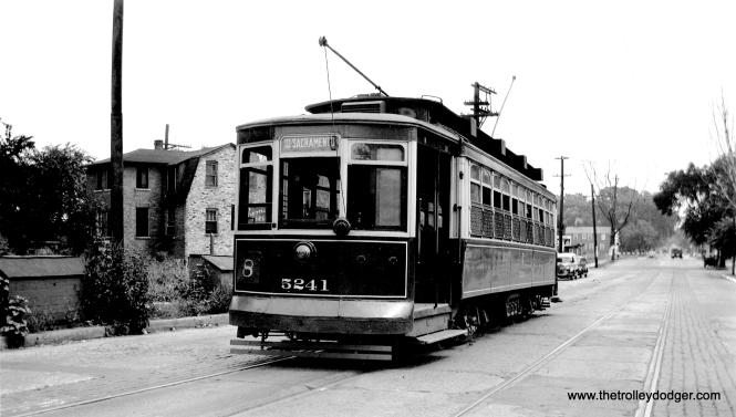 "Chicago Surface Lines 5241 on 111th Street near Vincennes on August 3, 1947. The sign on the front of the car indicates this was on through route 8. According to www.chicagrailfan.com, ""Various Through Route combinations existed throughout the early history of this route. Original Through Route operated between Grace/Halsted and 63rd/Stony Island via Halsted and 63rd St. Beginning in 1912, some Halsted service, mainly route 42 Halsted-Downtown service, began operating south of 79th St. via Vincennes and 111th St. to Sacramento, over what now is the 112 route. While for most of through service continuing north on Halsted, the south terminal remained 79th St. Effective 5/24/31, the through Halsted service generally turned around at 111th/Sacramento, with the downtown service generally turning at 79th St. Through service south of 79th St. discontinued 12/4/49, when segment south of 79th St. was converted to buses."" (John F. Bromley Collection)"