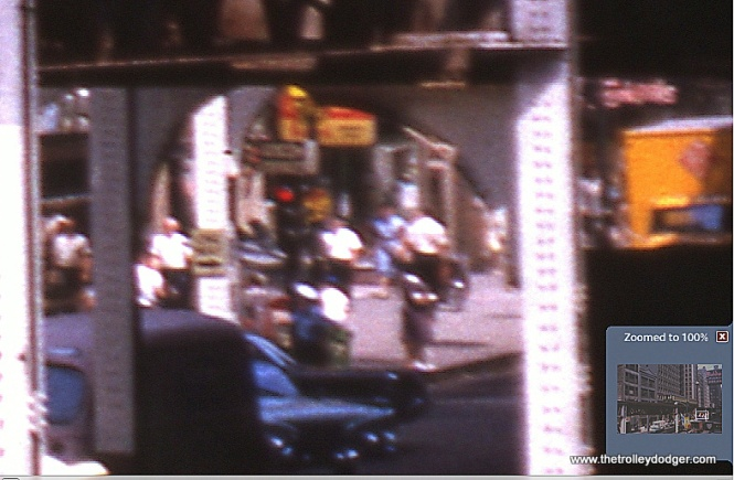 Enlarging a small section of the slide shows the Kodak sign in front of Central Camera at 230 S. Wabash.
