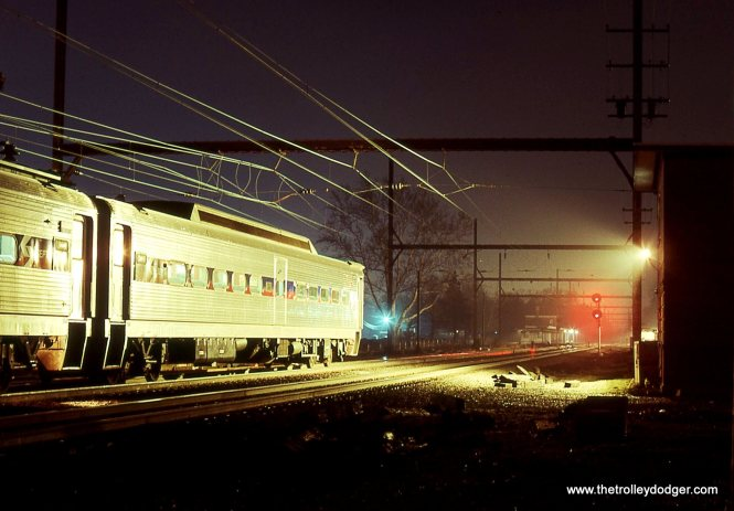 "This is the same SEPTA train of Silverliners that is seen in the previous photo. I walked around ""TRENT"" tower and took this photo looking east. The Ex-Reading Company passenger station is just visible past the tower to the right center of the photo. 4/6/01"