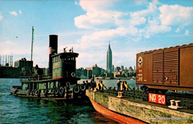 "The BEDT tug ""Invincible"" nudges a car float on the Brooklyn side of the East River in June 1956."