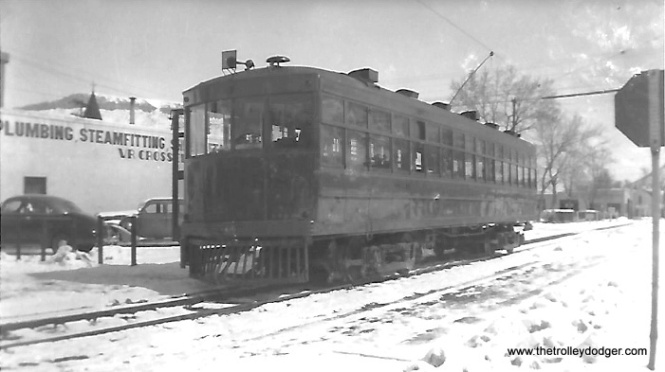 "Tony Manthos: ""Interurban 818. The snow tempted me to Denver & Intermountain 818 but I believe it had a center door."" Don Ross: ""818 is Denver. The center door was only on one side."" http://donsdepot.donrossgroup.net/dr2234.htm"