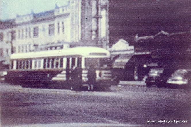 "A CSL ""tiger stripes"" car near the old State Theatre, which was located at 5814 W. Madison. (John Marton Collection)"