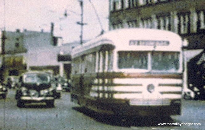 "A CTA prewar car in ""tiger stripes"" on 63rd Street. (John Marton Collection) Andre Kristopans: ""The shot of the prewar car on 63rd in tiger stripes between shots of 4018 and 4010 is just east of 63rd and Indiana. For some reason, 63rd St is offset to the south about 50 feet from State to Indiana, this is why there appears to be a curve behind the car, as there really is a jog there."""