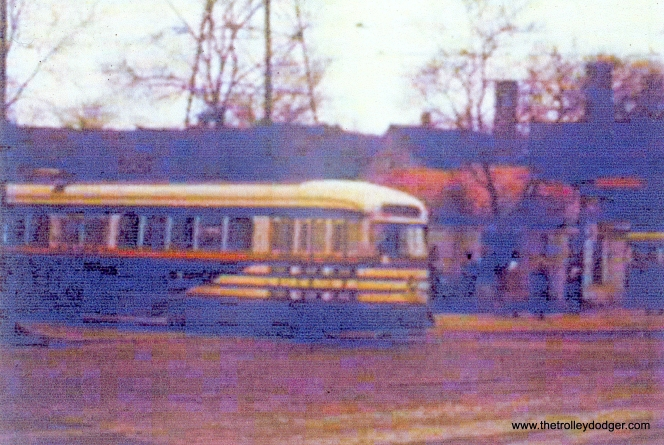 """Tiger stripes"" on route 20 - Madison, leaving the Madison-Austin terminal. (John Marton Collection)"
