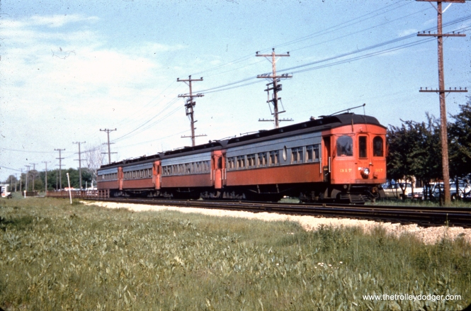 CA&E 317 is part of a four-car train of woods.