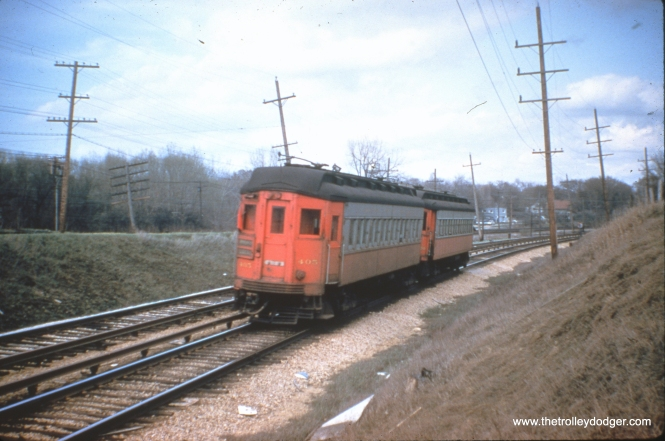 "CA&E 405 is part of a two-car train. Nancy Grove Mollenkamp: ""This is identified by Mark Llanuza as being taken in 1956 between the College Ave station in Wheaton and Glen Ellyn. Photographer unknown."""