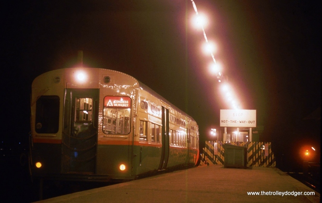 "Originally, I thought this was early 1960s night shot showed a CTA single-car unit in the 1-50 series, and those cars were used on the Congress-Douglas-Milwaukee line. But as Andre Kristopans has pointed out, the doors on those cars were closer to the ends than this one, which he identifies as being part of the 6511-6720 series. It just looks like there's one car, since the other ""married pair"" behind it is not illuminated. This picture was most likely taken at the end of the line at DesPlaines Avenue. Anyway, this prompted some interesting correspondence with Andre Kristopans on the Philly Traction Yahoo Group."