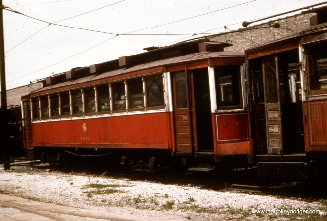 """CSL/CTA streetcar 1497 was renumbered as AA85 for work service as a salt spreader, the configuration we see it in here in this 1950s photo. It was scrapped on September 27, 1956. This was known as a """"Bowling Alley"""" car. Don's Rail Photos: """"1497 was built by CUTCo in 1900 as CUT 4546. It was rebuilt as 1497 in 1911 and became CSL 1497 in 1914. It was rebuilt as salt car and renumbered AA85 on April 15, 1948."""""""