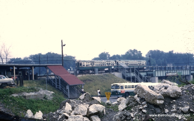 "In this June 1962 view. we see the CTA's DesPlaines Avenue terminal as it had been reconfigured in 1959. these very basic amenities continued n use until the station was rebuilt in the 1980s. I would assume that the pile of rubble in the foreground was related to the recent construction of a new maintenance facility here. The nearby expressway had been in operation since 1960. Presumably, the CTA bus is running route 17, which replaced the Westchester ""L"" branch in 1951. (George Niles Photo)"