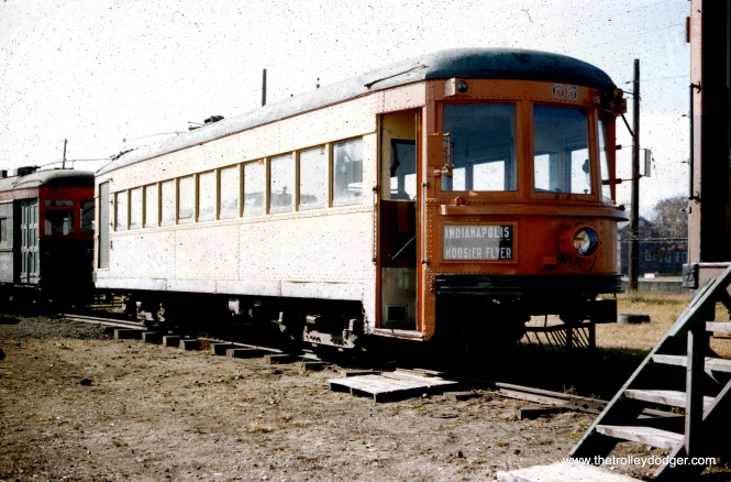 Indiana Railroad hi-speed lightweight interurban car 65 at the Illinois Electric Railway Museum in North Chicago in October 1956. It had last run in 1953 on the CRANDIC (Cedar Rapids and Iowa City) before being purchased by the museum as their first acquisition. That's Chicago & Milwaukee Electric 354, another early purchase, behind it.