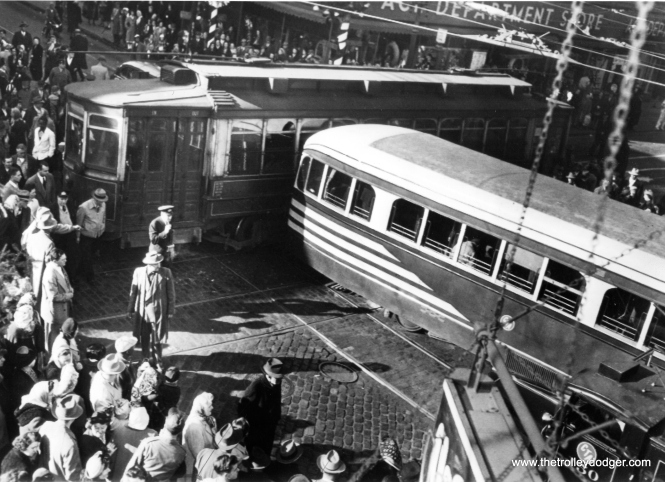 "On November 29, 1949 it was reported: ""At least 14 persons were reported injured, one critically, when two streetcars crashed at a busy intersection on the south side this afternoon. Several pedestrians were among the injured."" You can just barely see a CTA wrecker in the lower right corner of the picture. M. E. writes: ""In your latest post, ""Around Town"", the smashup dated 29 November 1949 is at 63rd and Halsted, looking northwest at the Ace department store. About that store, I remember it was rather dowdy and had no air conditioning. It had lots of ceiling fans instead. So it was hot in summer. On the southwest corner was an SS Kresge dime store. In the window was a doughnut-making machine, which was probably 15 feet long, most of which was a chute in which the donuts took shape. The price was 3 cents per doughnut. Kresge was predecessor to K-Mart. On the southeast corner were small stores, the largest of which was a Stineway drug store. Notice the spelling: Stineway rather than Steinway as in pianos. On the northeast corner was a big Sears department store, with a Hillman's grocery in the basement. I think I heard once that this Sears was the largest in Chicago other than the downtown Sears at State and Van Buren."""
