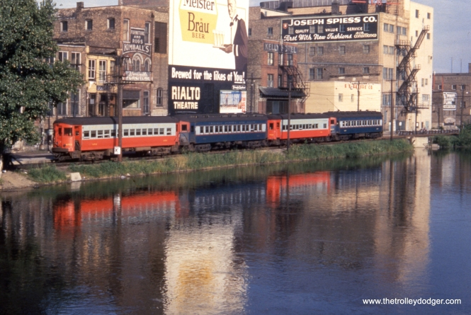 A four-car CA&E train gives a nice reflection in the Fox River at the Elgin terminal in the 1950s.