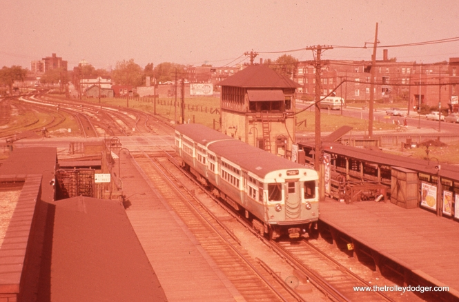 "Ray DeGroote took this picture at the old CTA Garfield Park ""L"" Laramie stop on May 1, 1955. We are looking to the west. About 30 years later, he had a duplicate slide made for me. That's what I scanned. Chances are, the original slide looks even more red than this today."