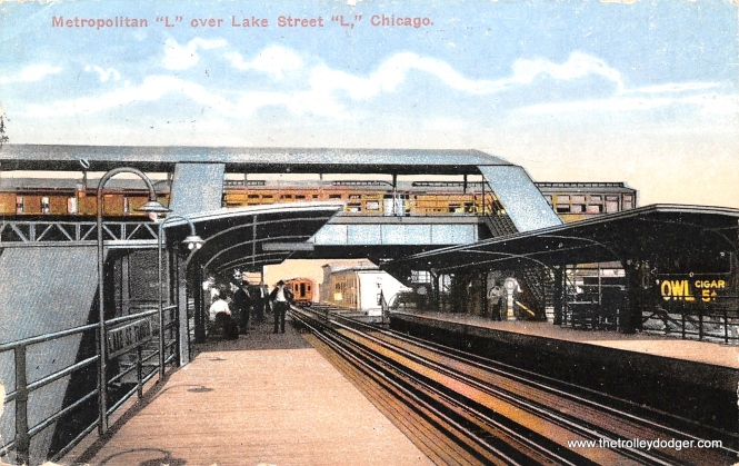 "The old Lake Transfer station was unique in that one ""L"" branch crossed over another. Here, a Met train is at top, passing over the Lake Street ""L"", in this circa 1914 postcard view."