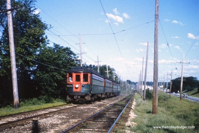 NSL 182 and train at St. Mary's Road (Thornbury Village) on the Mundelein branch on May 31, 1962. Notice the difference in right-of-way construction here, versus the main line.