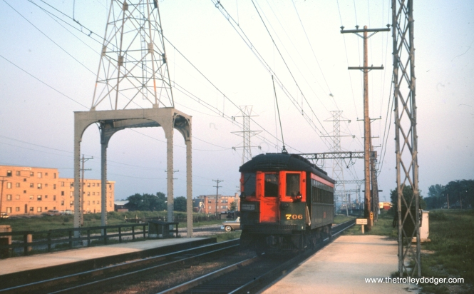 "NSL 706 heads south from Dempster in this June 9, 1961 photo by Clark Frazier. This is the current terminal of the CTA Yellow Line. The area under the electrical tower at left is where the ""pocket"" track went, when this was the end-of-the-line for the CRT's Niles Center Branch. This local service ended in 1948. CTA ""L"" service resumed here in 1964."