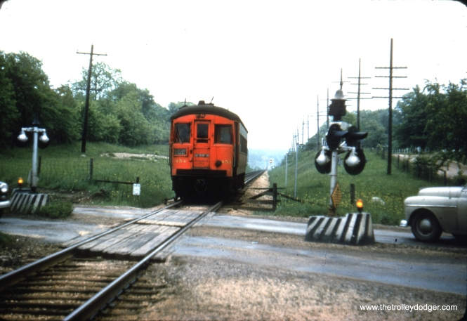 "CA&E 454 at an unidentified location. Nancy Grove Mollenkamp: ""This slide was identified by someone in a Wheaton FB group as being taken in 1952 at Jewell Road in Wheaton. Another person in the group said he believed it was looking south. He thinks that is Electric Avenue on the right or west."""