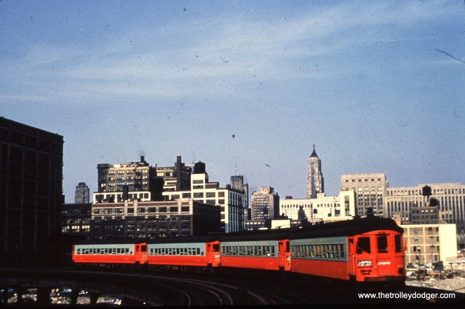 One can only wish that the photographer had aimed the camera a bit lower, but nonetheless, CA&E 428 is part of a four-car train in July 1953 on the Halsted curve.