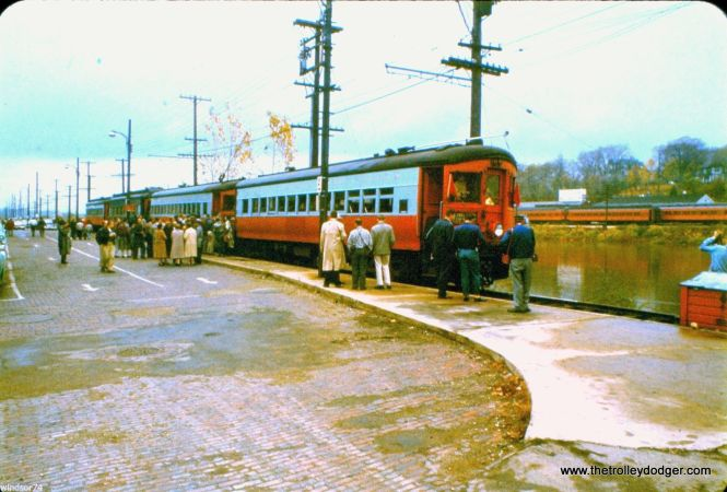 My guess is this 1950 CA&E scene shows the end of the line in Elgin, If so, the commuter rail coaches on the other side of the river belong to the Milwaukee Road.
