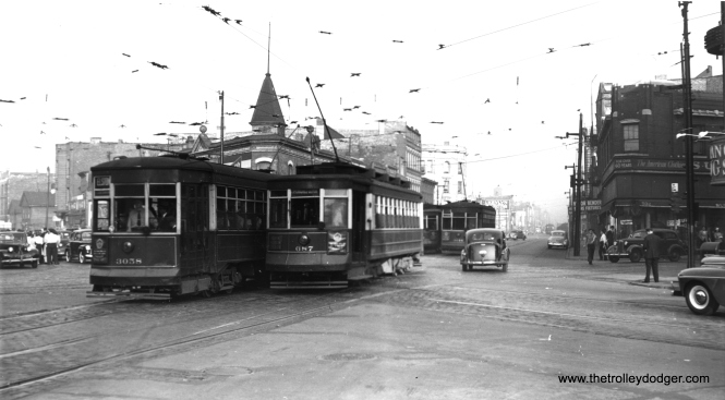 CSL 3058 passes car 687 on Milwaukee at the intersection with Grand and Halsted. (Robert V. Mehlenbeck Photo, Joe L. Diaz Collection)