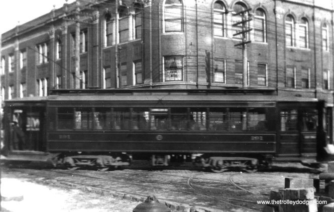 "Motion blur makes it hard to read the car number, but this is a Pullman in the (natch) ""Pullman green"" color scheme prior to the adoption of red in the 1920s. One of our regular readers writes, ""Chicago Railways Pullman No. 191. Note the Chicago Railways logo on the side of the car. The CRys logo was very similar to the CSL logo. This photo was probably taken between 1908 and 1914 when CSL started operations. The cars were not painted red and cream until the early 1920s when CSL adopted that color scheme."" (Fred J. Borchert Photo, Edward Frank, Jr. Collection)"
