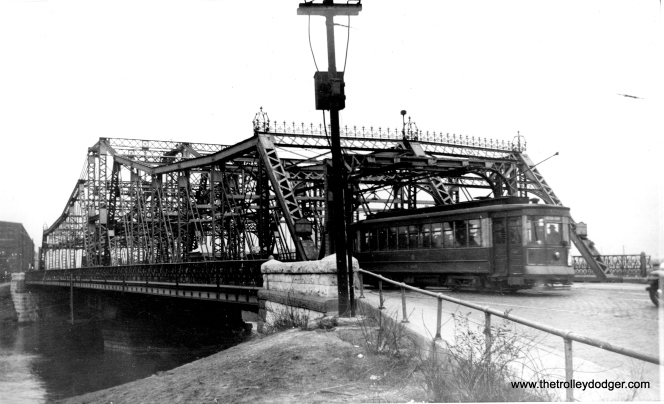 "Again, maybe one of our readers can help identify this bridge. Andre Kristopans: ""The second bridge photo is much harder to ID. However, notice that while the bridge is for lanes, the streetcar is on the ""wrong side"", as both tracks are on the near half of the bridge!"" Perhaps the bridge was expanded at some point, and the car tracks were left on the one side only. (Edward Frank, Jr. Photo)"