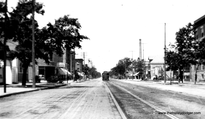 "One of our regular readers thinks this photo shows Evanston Avenue (now Broadway) between Devon and Lawrence. ""I believe that the streetcar is a Chicago Union Traction car, but it is too far away in the photo to identify. I believe that the view is looking north somewhere in Edgewater."""