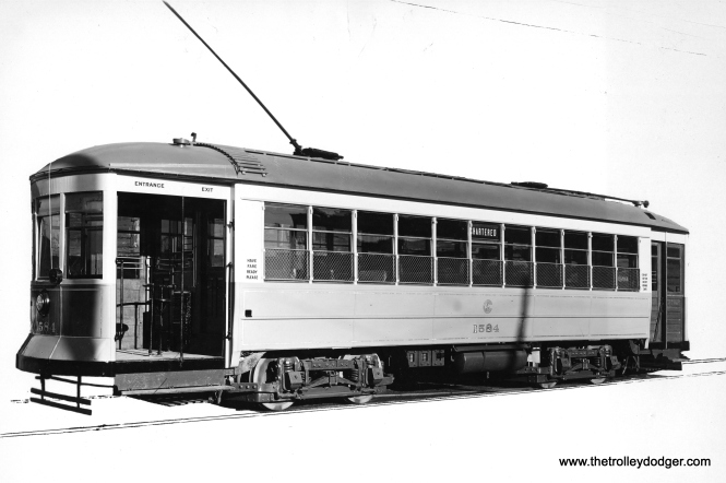 "CSL 1584 was a Chicago Railways car, built in 1912. Don's Rail Photos: ""These cars were improved versions of the Pullmans of a couple years earlier."" It's odd that the car body would appear so light. It would have been dark green originally, then red starting in the early 1920s. Even if orthochromatic film had been used, this would have rendered the red darker than usual, not lighter. Perhaps it is just a ""trick of the light."""