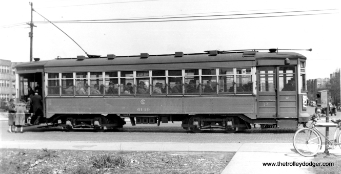 CSL 6149, an Odd 17 car built by CSL in 1919, is on through route 1 (Cottage Grove-Broadway), which ran from 1912 until October 7, 1946. The bicycle at right is very likely the photographer's. Ed Frank rode his bike all over the city instead of taking the streetcar, so he could save money to buy film. (Edward Frank, Jr. Photo)