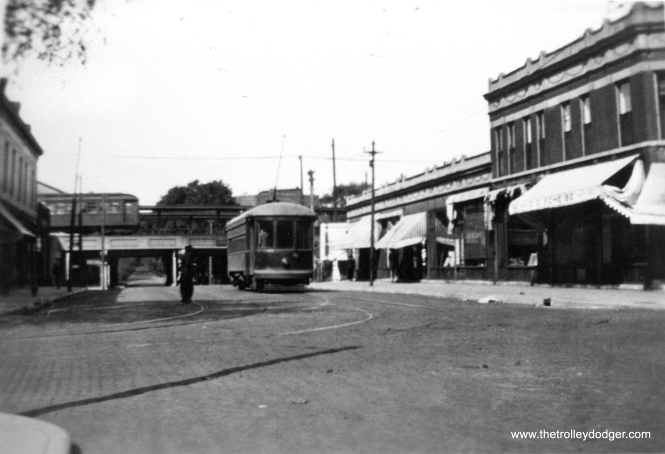 "An Evanston Railways car on Dempster Street, with the ""L"" in the background. We are looking west from the corner of Dempster and Chicago. Evanston Railways pictures are as scarce as hen's teeth. The ""L"" was elevated between 1908 and 1910. This picture was taken sometime between 1913, when ER got these cars, and 1935, when streetcars were replaced by buses."