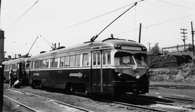 """Car 12 in August 1952. Garrett Patterson: """"Llanerch Car house."""" Kenneth Achtert: """"That shot of #12 in August 1952 would be at the Llanerch car barn. The street at the top of the hill behind the cars is West Chester Pike, and the car barn structure is to the right out of the frame."""" (Arthur B. Johnson Photo)"""