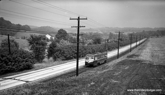 """Car 19 along West Chester Pike. What was once a """"side of the road"""" operation is now part of the road. This long view gives you some idea of the distances involved on this 19-mile line."""