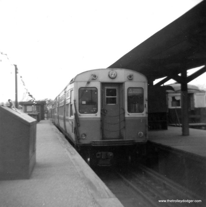 "CTA 6698 at DesPlaines Avenue terminal in June 1963. The track at right, where an old wooden ""L"" car is being used as an office, was originally intended for use by CA&E trains, if service could have resumed in 1959. (George Trapp Photo)"