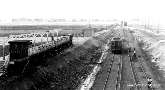 The CRT Westchester branch at Roosevelt Road, circa 1929-1930. Service along this line opened in 1926, and when the line was extended, local officials insisted that tracks not cross Roosevelt at grade, thereby necessitating this grade separation project. The platform at left was later moved into the open cut, although the original station house was retained. Service to Mannheim began in 1930. The line was abandoned in 1951. We are looking north. (Allen T. Zagel Photo, George Trapp Collection)