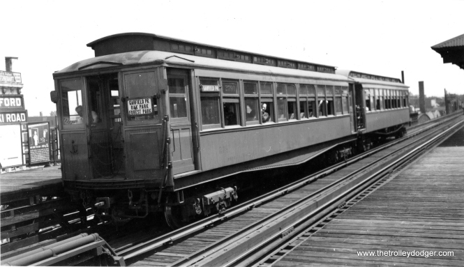 "No, these two cars are not going downhill. But if you level out the picture, you can't see the sign identifying this as the Pulaski Road station on the Garfield Park ""L"". Based on the sign on this car, I would say the train is heading west. (Joe L. Diaz Photo, George Trapp Collection)"