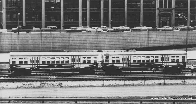 "CTA experimental high-speed cars 6129-6130 in the ""Morgan middle"" tracks on the Congress line circa 1960. Fans referred to the cars in this paint scheme as ""circus wagons."" (George Trapp Collection)"
