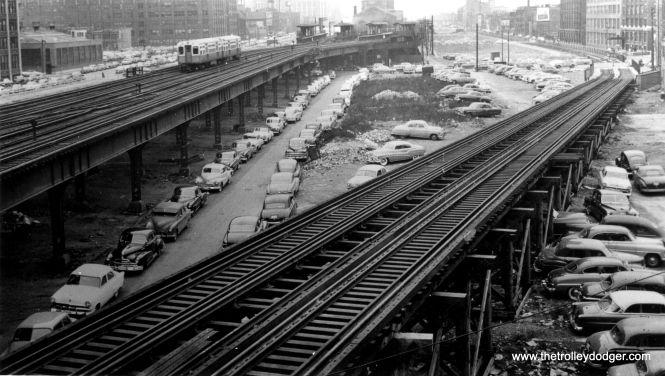 "We are at the east end of the Van Buren trackage, which connected to the old ""L"" structure at Aberdeen (1100 W.). That is the Racine station at left. Service on a portion of the old ""L"" would have continued until the Spring 1954, until a new connection was built to allow Douglas Park trains to access the Loop via the Lake Street ""L"". We are looking west. This area is now occupied by the Eisenhower Expressway. (Allen T. Zagel Photo, George Trapp Collection)"