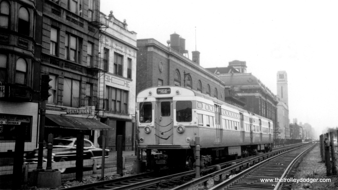 In the mid-1950s, a two-car train of flat door 6000s heads west at Paulina (1700 W.), about to cross under tracks now used by the CTA's Pink Line. The building with the tower is located at 333 S. Ashland. (Allen T. Zagel Photo, George Trapp Collection)