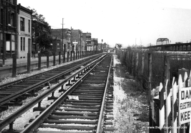 "This September 1953 view of the new Van Buren trackage looks east from (I think) California Avenue (2800 W.). The photo caption reads, ""CTA Elevated tracks on surface (due to) construction (of the) Congress St. expressway. At time of photo trains still using El structure at right of picture."""