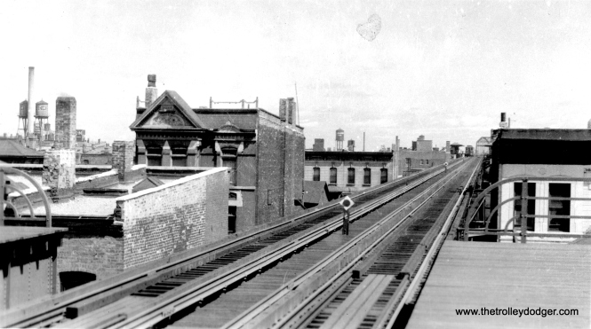 This is a Logan Square branch station along Paulina Street, looking north. It cannot be Marshfield, since the tracks went off from that point via a curve. In the background, we see the bridge over the Milwaukee Road and Chicago & North Western tracks. This bridge is still there, used for signals. The old Lake Transfer station is just south of the bridge. Therefore, by a process of elimination, I'd say this is most likely the old Madison Street station. There is no station at this location now (although some would like to see one built, to serve the nearby United Center), but the tracks are still in place for use by the CTA Pink Line. (George Trapp Collection)