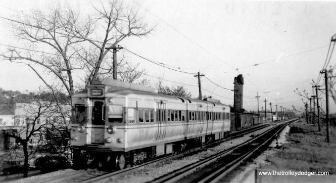 "One of the 5001-5004 ""Doodlebugs"" in Evanston. George Trapp says this is ""car 5003, one of the St. Louis built pair. Compare with photo of car 5001 and notice different trolley shrouds, roof air intakes, end windows, end door windows and destination sign windows. St. Louis cars also had stainless steel grab irons as did 6001-6200."" (Allen T. Zagel Photo, George Trap Collection)"