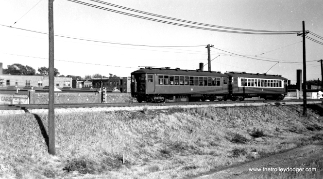 Two 4000s in Evanston, one repainted in CTA colors, and the other still in CRT brown. George Trapp says the repaintings began around 1952. (Allen T. Zagel Photo, George Trapp Collection)