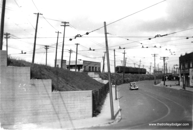 "Chicago Avenue in Evanston. Bill Shapotkin adds, ""Nice view of the Calvary C&NW passenger station in these two pix (this one and the next). Note that there was an elevator (not for ADA, but for funeral caskets)."" (Edward Frank, Jr. Photo, George Trapp Collection) Miles Beitler adds,""This photo shows a four car CRT train."""