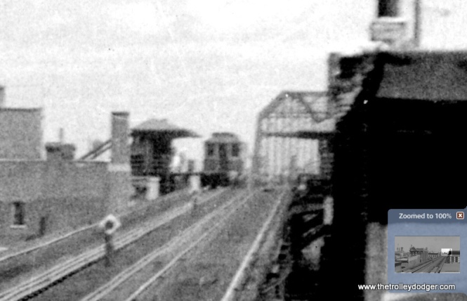 "A blow-up of the previous picture shows Lake Transfer station in the distance. This is where the Met ""L"" along Paulina crossed over the Lake Street line, before continuing north over the bridge shown in the background. The tracks north of Lake were removed in 1964, but the bridge was kept in place for use by signals on the Milwaukee Road and C&NW tracks below. (George Trapp Collection)"