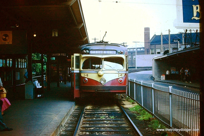 """Double-end car 14, a product of St. Louis Car Company, signed for Sharon Hill in the 69th Street Terminal circa 1954. Garrett Patterson: """"Where #14 is shown loading at 69th St., the track was paved to street rail condition days before the cessation of West Chester car service for the startup of the W Bus which took its place."""""""