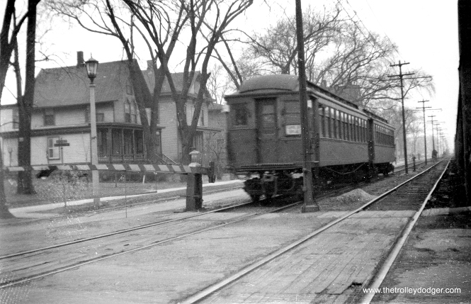 An inbound Lake Street Local somewhere in Oak Park prior to the adoption of A/B service in 1948. The outer portion of the line, from about Oak Park Avenue west, did not have fencing. There were numerous manually operated grade crossings along the 2 1/2 miles where trains ran on the ground. (George Trapp Collection)