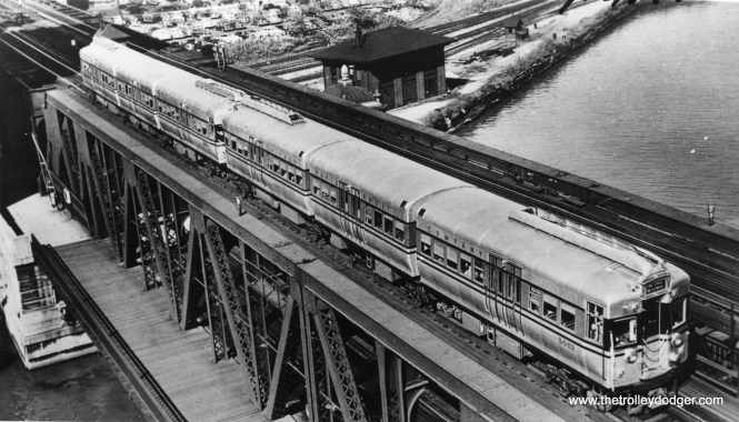 "A pair of shiny new 5000s (first pair is 5001-5002) on the Lake Street ""L"" bridge over the Chicago River, circa 1947-48. (Allen T. Zagel Photo, George Trapp Collection)"