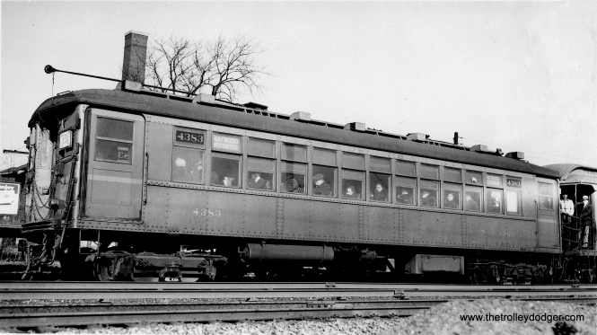 "CRT 4383 is signed as going to Maywood and Westchester via the Garfield Park ""L"". It is coupled to an older gate car. We are at one of the ground-level stations. (George Trapp Collection)"