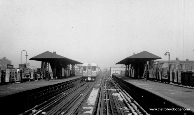 This certainly has the appearance of a Met station. Looking at this photo under magnification shows the bridge in the background, and some of the buildings, match up with the old station at Madison and Paulina. The presence of 6000s here would date the picture to late 1950 or early 1951, before the Dearborn-Milwaukee subway went into service. We are looking north. We posted another photo taken towards the north end of this station in our post Chicago Rapid Transit Photos, Part Four (September 20, 2016). (George Trapp Collection)